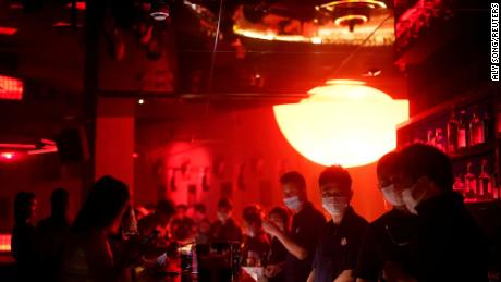 People wear face masks at a nightclub in Shanghai.